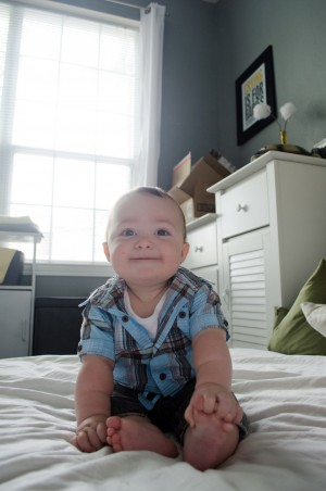 Miles - 9 Month baby photos - Smiling and grinning as he leans forward