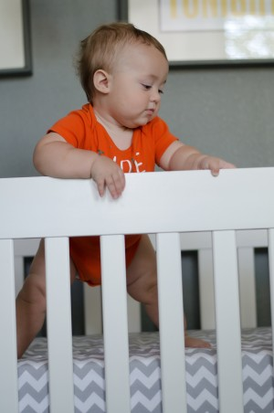 Miles | 10 months - standing in his crib and exploring the perimeter