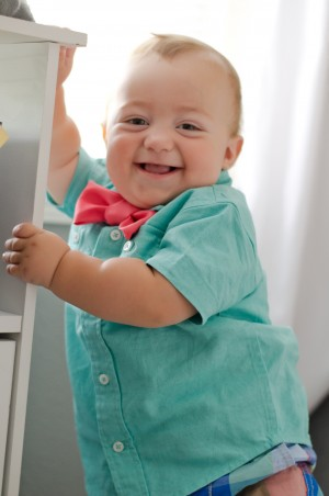Miles | 10 months - Standing up at his nursery end table and laughing