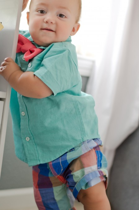 Miles | 10 months - Standing up at his nursery end table - love the shorts