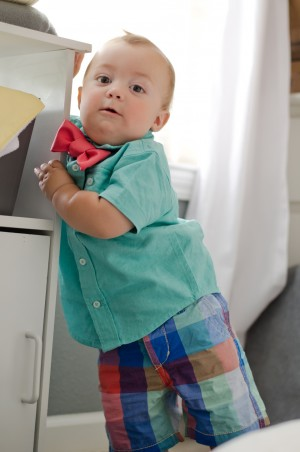 Miles | 10 months - Standing up at his nursery end table - love the shorts and expression